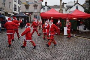 Dancing Santas in Ulverston Market Street